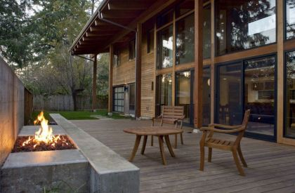 The Wooden Mulligan Residence #terrace #fireplace